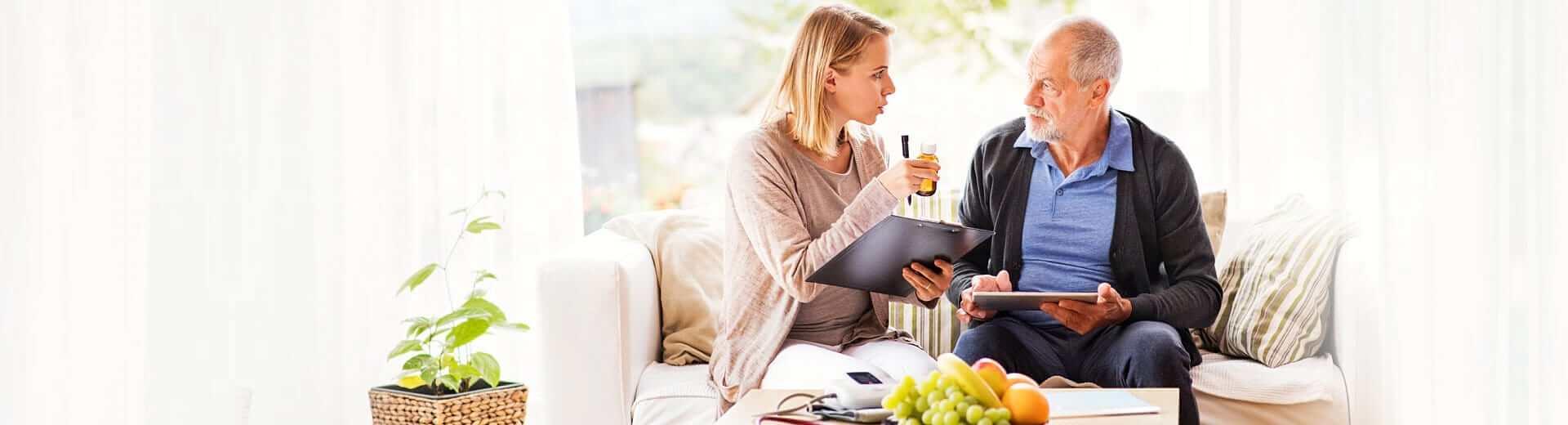 caregiver explaining to senior man